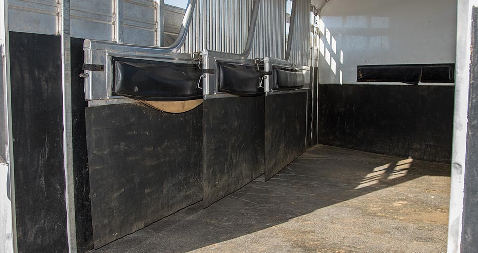 Move trailer dividers so horse has more room.